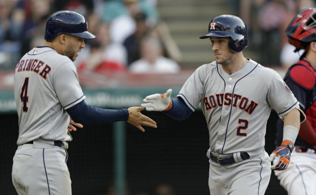Houston Astros' Alex Bregman (2) and George Springer (4) celebrate after Bregman hit a three-run home run in the fifth inning of a baseball game against the Cleveland Indians, Thursday, May 24, 2018, in Cleveland. (AP Photo/Tony Dejak)