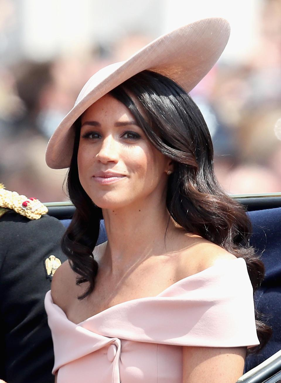 <p>For her debut Trooping the Colour parade on June 9, Meghan sought inspiration from the Duchess of Cambridge as she debuted seriously glossy waves. <em>[Photo: Getty]</em> </p>