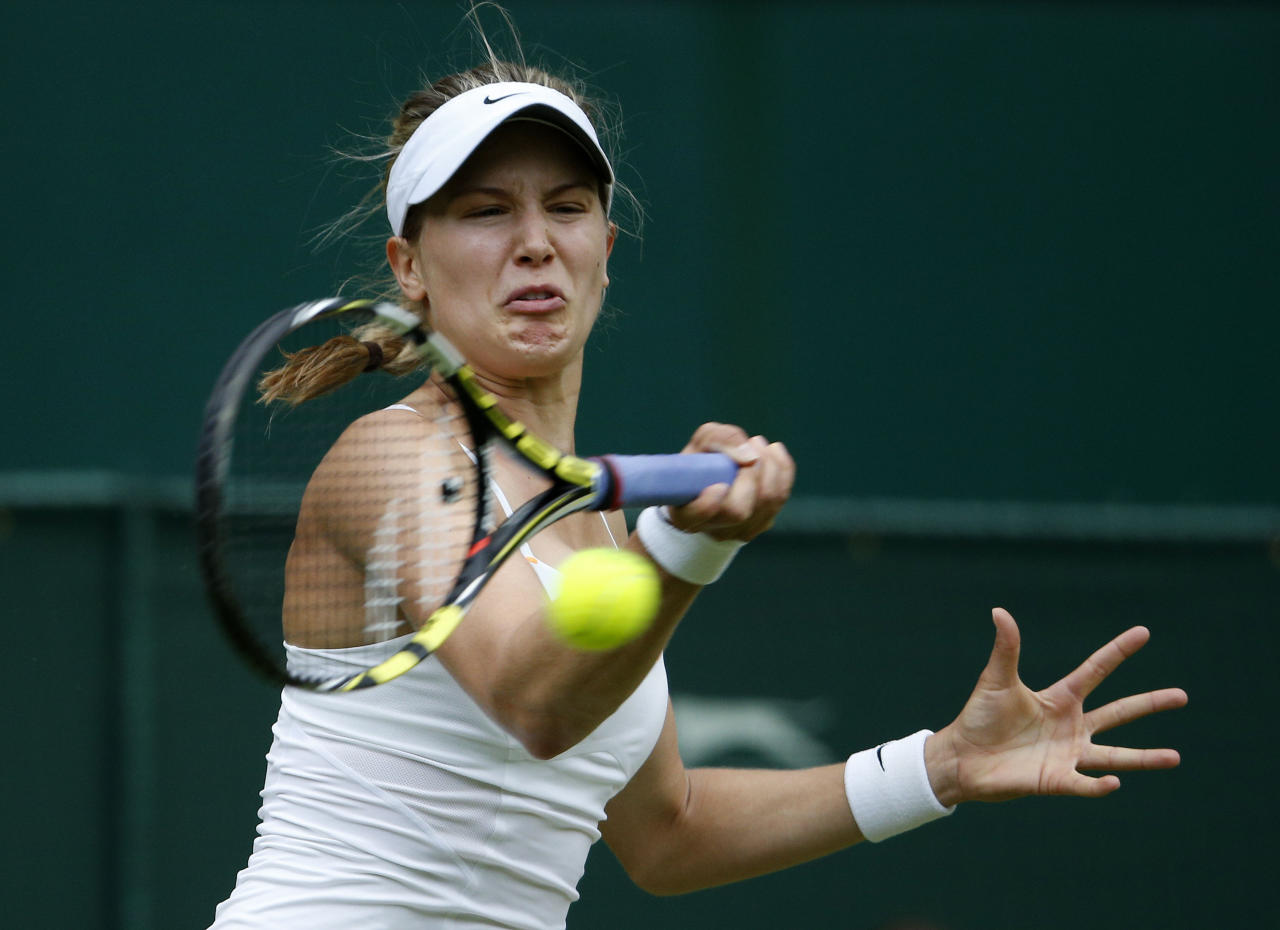 Canada's Eugenie Bouchard in action against Serbia's Ana Ivanovic during day Three of the Wimbledon Championships at The All England Lawn Tennis and Croquet Club, Wimbledon.