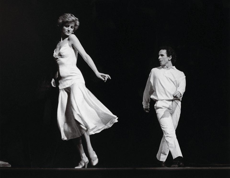 """<p>Diana left an audience of 2,500 at the Royal Opera House speechless after a 1985 duet with dancer Wayne Sleep to Billy Joel's """"Uptown Girl."""" She had kept the routine under wraps until its debut at a benefit. Decades later, actors Emma Corrin and Jay Webb re-created the routine for season 4 of Netflix's <em>The Crown</em>.</p>"""