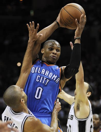 Oklahoma City Thunder point guard Russell Westbrook is defended by San Antonio Spurs point guard Tony Parker, left, of France, and Manu Ginobili, right, during the first half of Game 2 in their NBA basketball Western Conference finals playoff series, Tuesday, May 29, 2012, in San Antonio. (AP Photo/Darren Abate)