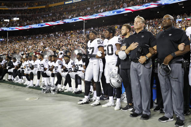 <p>Some members of the Oakland Raiders sit on the bench during the national anthem before an NFL football game against the Washington Redskins in Landover, Md., Sept. 24, 2017. (Photo: Alex Brandon/AP) </p>