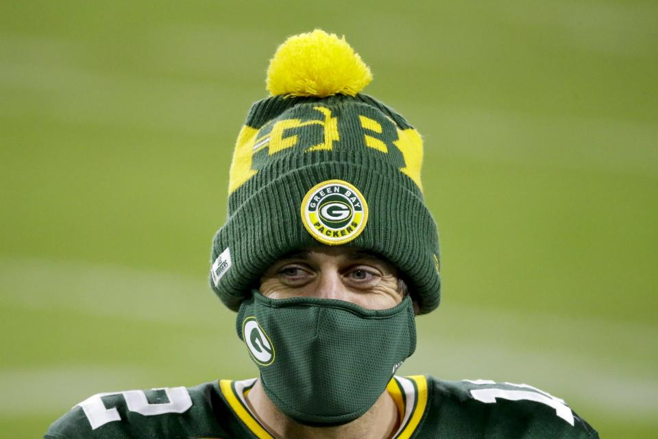 Green Bay Packers' Aaron Rodgers wears a mask after an NFL football game against the Philadelphia Eagles Sunday, Dec. 6, 2020, in Green Bay, Wis. The Packers won 30-16. (AP Photo/Mike Roemer)
