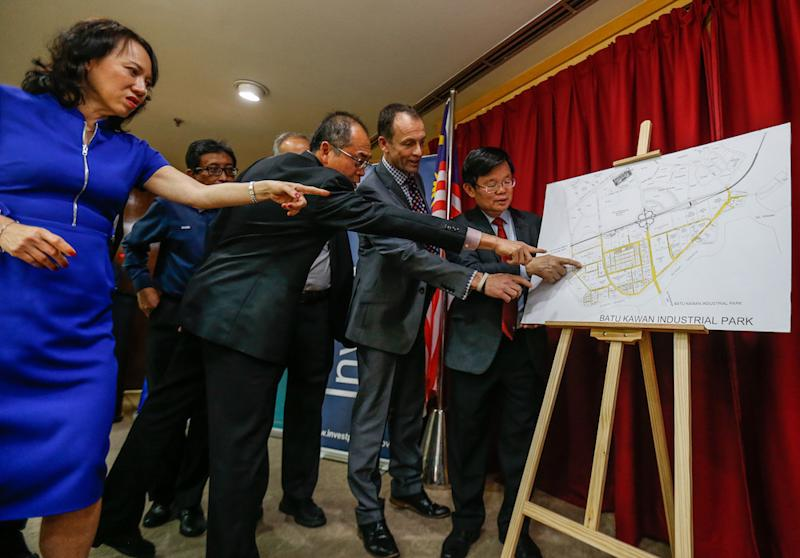 Penang Chief Minister Chow Kon Yeow and other VIPs look a plan for the Smith and Nephew High Technology Industrial Plant in George Town November 19, 2019. — Pictures by Sayuti Zainudin