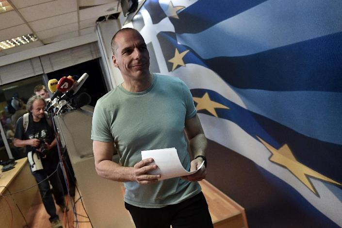 Greek Finance Minister Yanis Varoufakis leaves after speaking to the press in Athens on July 5, 2015 (AFP Photo/Aris Messinis)
