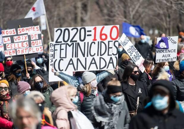 People take part in a demonstration to highlight violence against women in Montreal on Friday. (Graham Hughes/The Canadian Press - image credit)