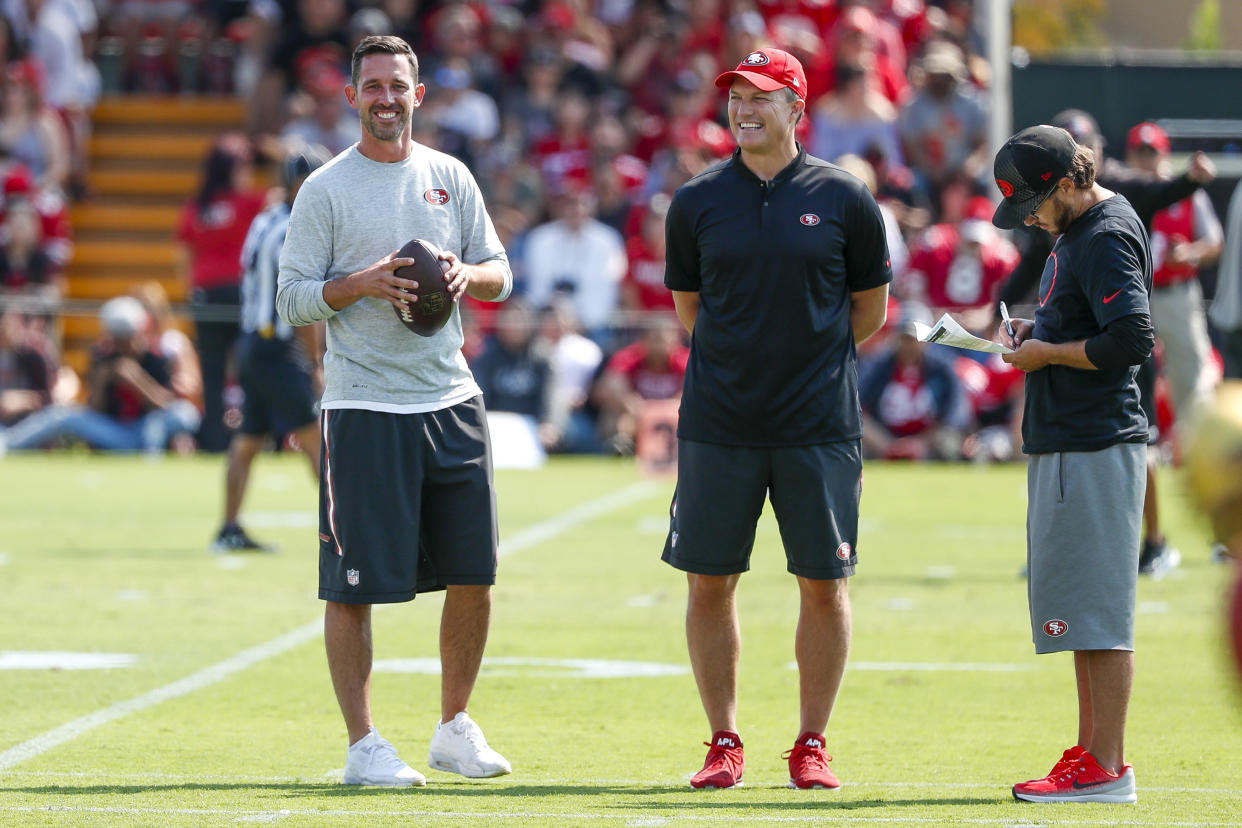 Niners general manager John Lynch (middle) appears to have missed badly in the first round of the 2017 NFL draft. (AP)