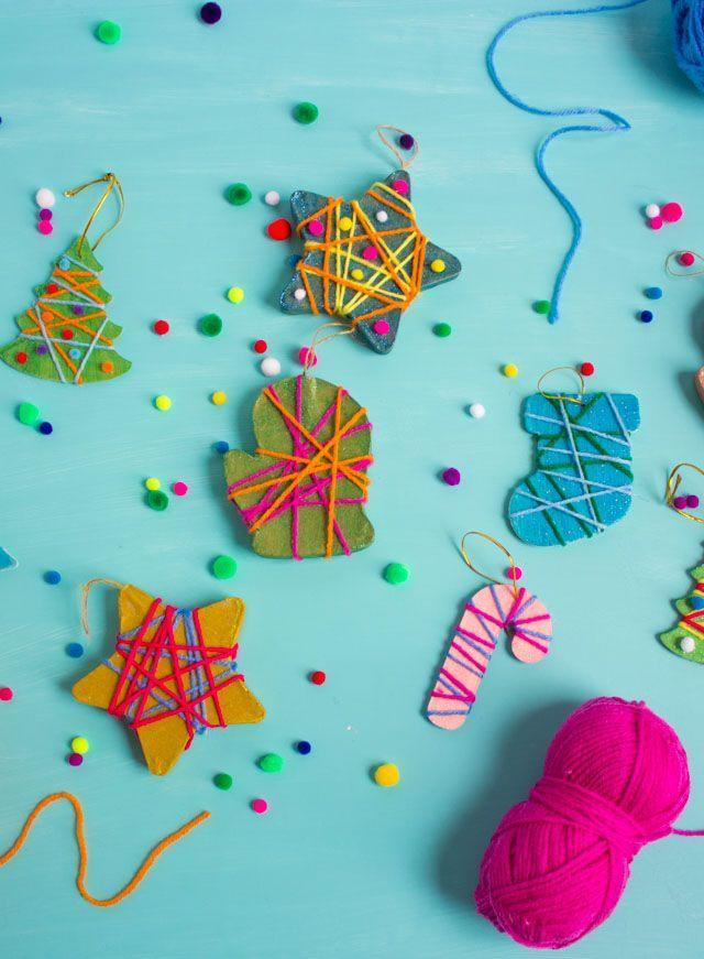 """<p>Set up a crafting table to keep your little ones entertained while the adults chat around the table. The kids can make these adorable yarn-wrapped ornaments all on their own, once you (or older cousins) cut out the shapes. They'll become treasured heirlooms as the years go on.</p><p><em><a href=""""https://designimprovised.com/2018/12/yarn-wrapped-christmas-ornaments.html"""" rel=""""nofollow noopener"""" target=""""_blank"""" data-ylk=""""slk:Get the tutorial at Design Improvised »"""" class=""""link rapid-noclick-resp"""">Get the tutorial at Design Improvised »</a></em></p>"""