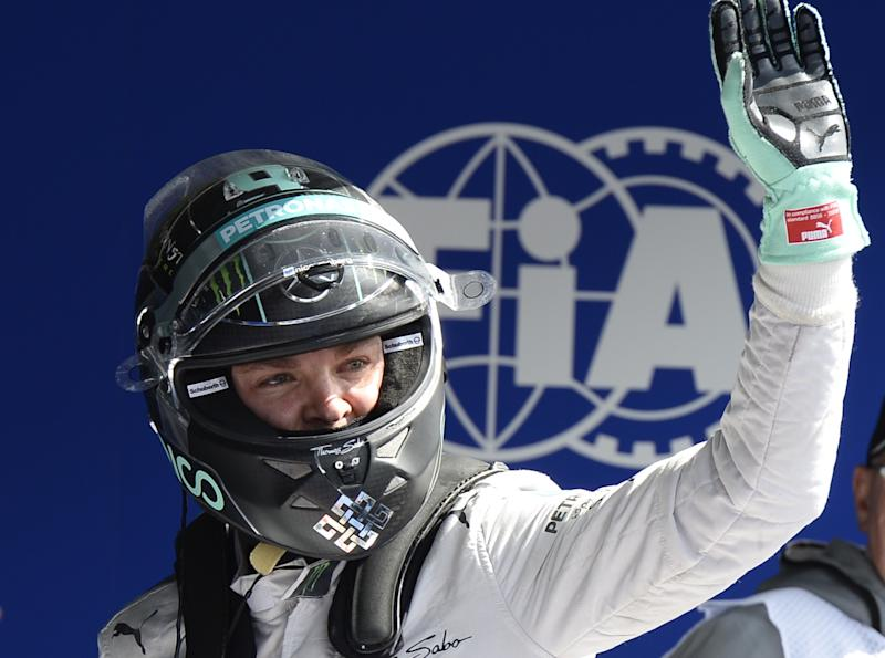 Mercedes-AMG's German driver Nico Rosberg celebrates after clocking the pole-position in the parc ferme at the Spa-Francorchamps circuit in Spa on August 24, 2014 after the Belgium Formula One Grand Prix (AFP Photo/Tom Gandolfini)