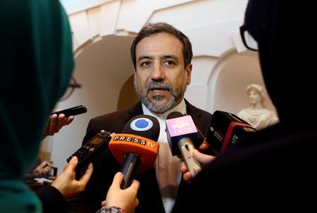 FILE PHOTO: Iran's top nuclear negotiator Araqchi talks to journalists after meeting senior officials from the United States, Russia, China, Britain, Germany and France in a hotel in Vienna