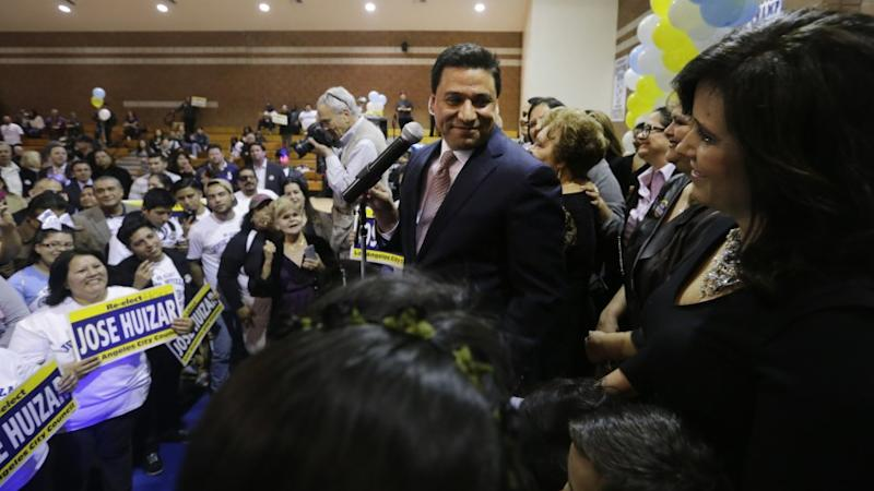LOS ANGELES, CA MAR. 03, 2015 Incumbant LA City Councilmember Jose Huizar acknowledging his wife Richelle R'os at the election headquarter at Salesian High School in LA on Mar. 03, 2015. LA City Council District 14 is a highly publicized race between former LA County Supervisor Gloria Molina and incumbant Jose Huizar (Lawrence K. Ho / Los Angeles Times)