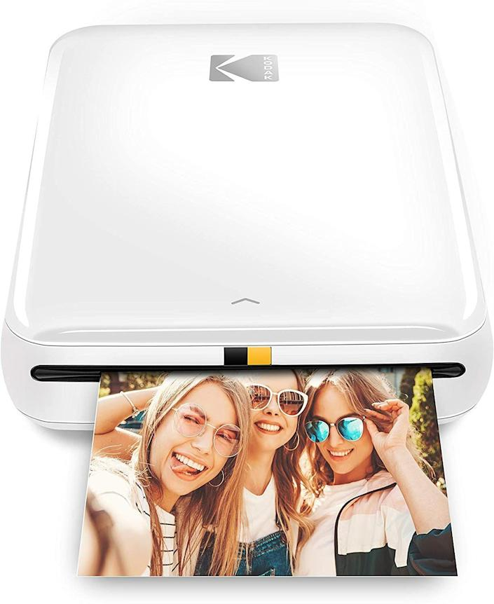 """<p><strong>Polaroid</strong></p><p><strong>$59.99</strong></p><p><a href=""""https://www.amazon.com/Wireless-Printer-Compatible-Android-Bluetooth-dp-B08C72V1LB/dp/B08C72V1LB/?tag=syn-yahoo-20&ascsubtag=%5Bartid%7C10050.g.25323076%5Bsrc%7Cyahoo-us"""" rel=""""nofollow noopener"""" target=""""_blank"""" data-ylk=""""slk:Shop Now"""" class=""""link rapid-noclick-resp"""">Shop Now</a></p><p>If she's going back to work, those long hours away from her bundle of joy are going to be tough. With this helpful gadget, she can print photos of him or her directly from her smartphone and immediately place them all over her office. </p>"""