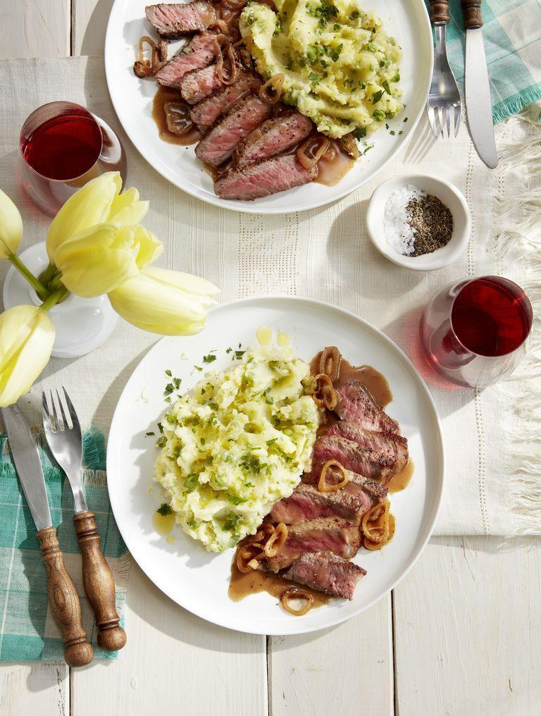 """<p>There's a good reason why steak is such a classic dinner for two—it's unbeatable! The lemon and pea mashed potatoes take this beloved side to the next level too.</p><p><strong><a href=""""https://www.countryliving.com/food-drinks/a26768155/strip-steak-lemon-mashed-potatoes-recipe/"""" rel=""""nofollow noopener"""" target=""""_blank"""" data-ylk=""""slk:Get the recipe"""" class=""""link rapid-noclick-resp"""">Get the recipe</a>.</strong></p><p><strong><strong><strong><strong><strong><strong><a class=""""link rapid-noclick-resp"""" href=""""https://www.amazon.com/Victoria-Skillet-Seasoned-Flaxseed-Certified/dp/B01726HD72/?tag=syn-yahoo-20&ascsubtag=%5Bartid%7C10050.g.1115%5Bsrc%7Cyahoo-us"""" rel=""""nofollow noopener"""" target=""""_blank"""" data-ylk=""""slk:SHOP SKILLETS"""">SHOP SKILLETS</a></strong></strong></strong></strong></strong><br></strong></p>"""
