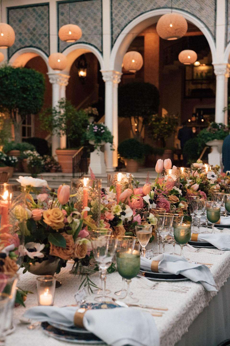 I loved the lush floral centerpieces—sprinkled with fruit!—that echoed the design of our wedding invitations and played off of our Haviland china. We added candlelight at multiple heights with tapers and votives to set the mood.