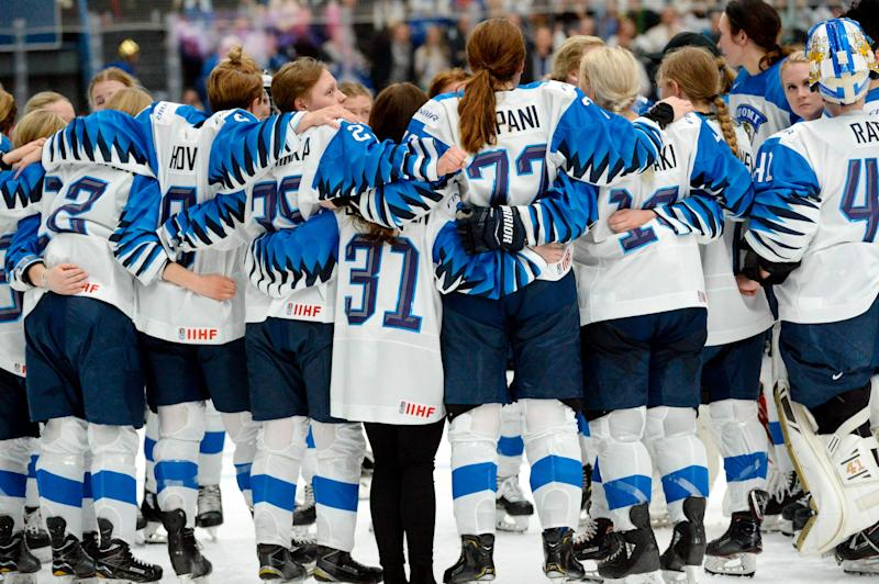 Finnish players wait for the referee's decision after Finland scored a game-winning overtime goal which was later disallowed during the IIHF Women's Ice Hockey World Championships final match between the United States and Finland in Espoo, Finland, on Sunday, April 14, 2019. (Mikko Stig/Lehtikuva via AP)