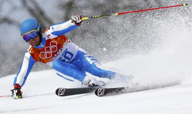 Italy's Davide Simoncelli skis during the first run of the men's alpine skiing giant slalom event at the 2014 Sochi Winter Olympics at the Rosa Khutor Alpine Center February 19, 2014. REUTERS/Dominic Ebenbichler (RUSSIA - Tags: SPORT SKIING OLYMPICS)