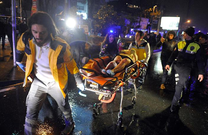 <p>DEC. 31 / JAN 1, 2016 –Medics carry a wounded person at the scene after an attack at a popular nightclub in Istanbul, early Sunday, Jan. 1, 2017. Istanbul Governor Vasip Sahin said that an armed assailant has opened fire at a nightclub in Istanbul during New Year's celebrations. Turkish authorities have banned distribution of images relating to the Istanbul attack within Turkey. (IHA via AP) </p>