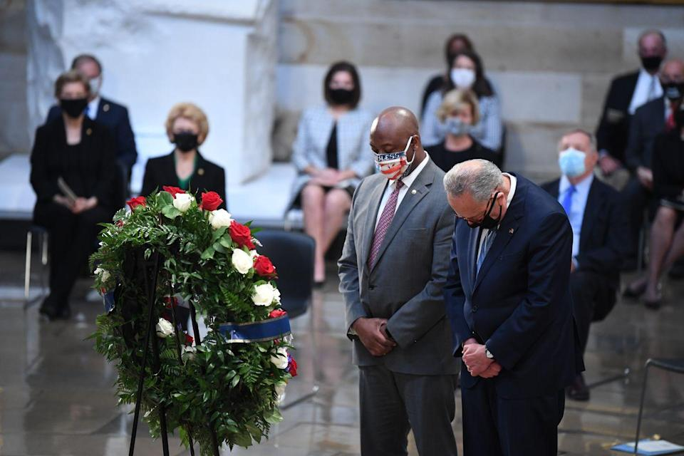 <p>Senator Tim Scott (R-SC) and Senator Chuck Schumer (D-NY) paid their respects at Representative Lewis's casket. </p>