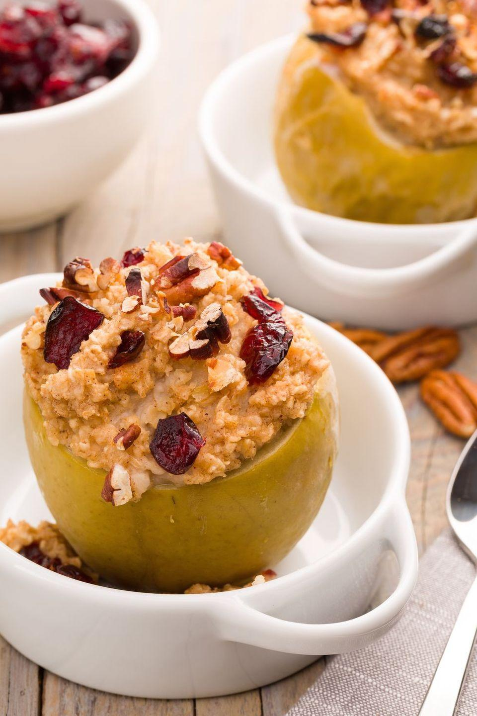 """<p>The only breakfast you should eat all autumn. Stuffed with porridge oats, cinnamon, and maple syrup, these baked apples are a good-for-you start to the day.</p><p>Get the <a href=""""https://www.delish.com/uk/cooking/recipes/a29017650/breakfast-baked-apples-recipe/"""" rel=""""nofollow noopener"""" target=""""_blank"""" data-ylk=""""slk:Baked Apple Breakfast"""" class=""""link rapid-noclick-resp"""">Baked Apple Breakfast</a> recipe.</p>"""