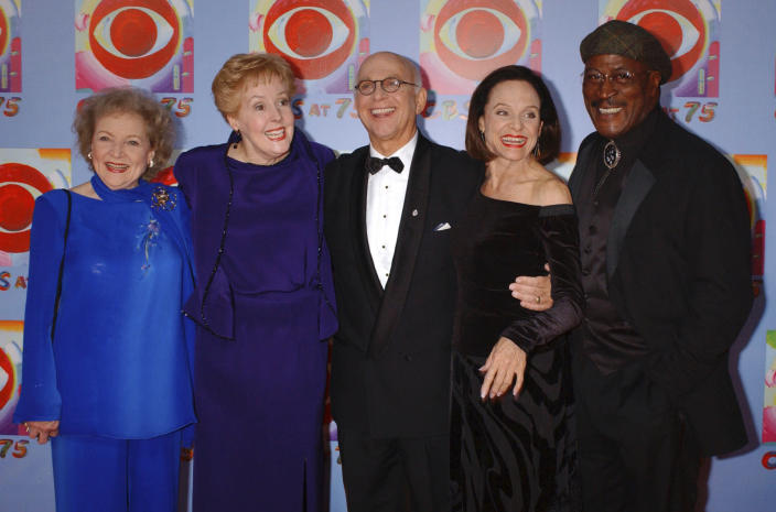 FILE - In this Nov. 2, 2003 file photo, actors Betty White, left, Georgia Engel, second left, Gavin MacLeod, center, Valerie Harper, second right, and John Amos pose for photographers during arrivals at CBS's 75th anniversary celebration in New York. Gavin MacLeod has died. His nephew told the trade paper Variety that MacLeod died early Saturday, May 29, 2021. (AP Photo/Louis Lanzano, File)