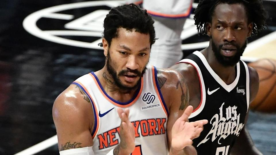 May 9, 2021; Los Angeles, California, USA; New York Knicks guard Derrick Rose (4) reacts to a referee's call going his way during the section quarter as LA Clippers guard Patrick Beverley (21) looks on at Staples Center.