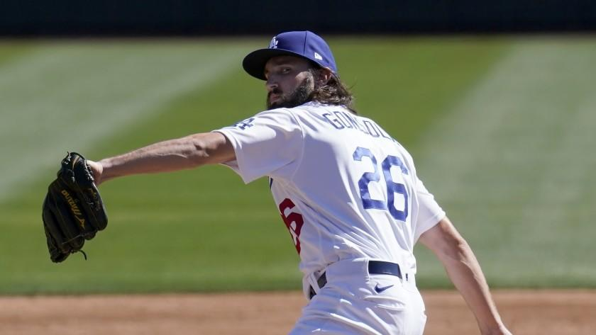 Los Angeles Dodgers pitcher Tony Gonsolin throws a pitch against the Colorado Rockies.