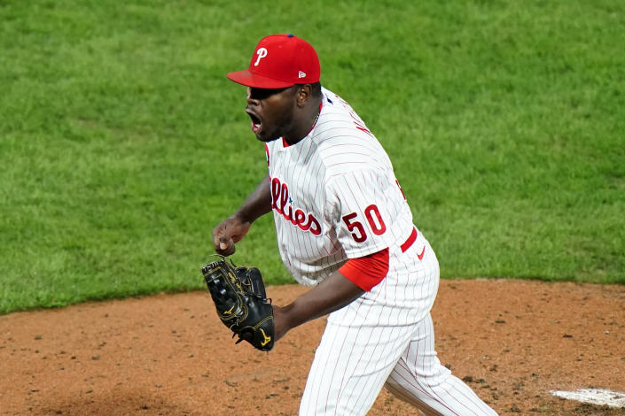 Philadelphia Phillies pitcher Hector Neris reacts after winning a baseball game against the New York Mets, Tuesday, Sept. 15, 2020, in Philadelphia. (AP Photo/Matt Slocum)