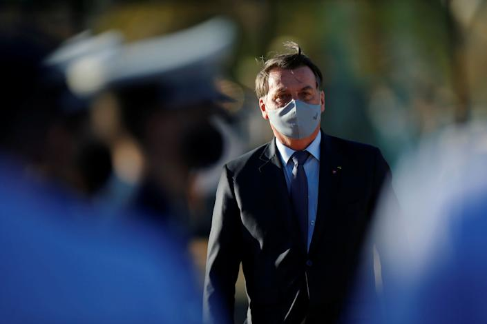 Brazil President Jair Bolsonaro has rivaled U.S. President Donald Trump in downplaying the seriousness to the coronavirus pandemic. He has scorned a strong public response to the crisis. And his now-positive test for COVID-19 is unlikely to cause any change in his attitude. (Photo: Adriano Machado / Reuters)