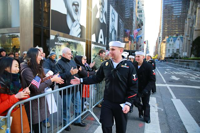 <p>Personnel from the United States Navy thank spectators during the Veterans Day parade in New York City on Nov. 11, 2017. (Photo: Gordon Donovan/Yahoo News) </p>