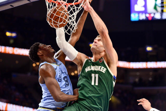 Milwaukee Bucks center Brook Lopez (11) dunks against Memphis Grizzlies forward Jaren Jackson Jr. (13) in the second half of an NBA basketball game Friday, Dec. 13, 2019, in Memphis, Tenn. (AP Photo/Brandon Dill)