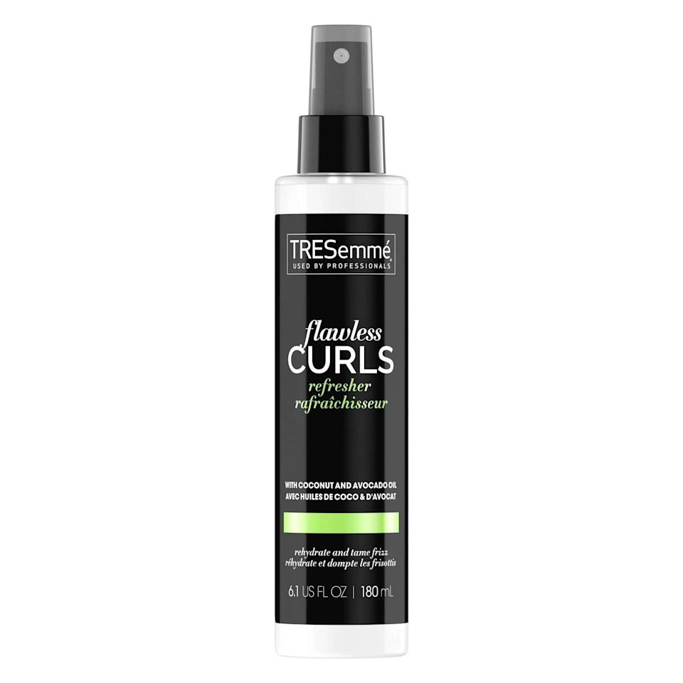 """Tresemmé's Flawless Curls Refresher is a moisturizing dream for dehydrated, frizzy curls. The formula replenishes hair in a way that water alone can't do, thanks to its star ingredients coconut and avocado oil, which deeply hydrate hair without adding excess weight. Save time from styling by spritzing the product on dry hair on <a href=""""https://www.allure.com/story/moisturize-natural-hair-between-washes?mbid=synd_yahoo_rss"""" rel=""""nofollow noopener"""" target=""""_blank"""" data-ylk=""""slk:non-washdays"""" class=""""link rapid-noclick-resp"""">non-washdays</a>. Or, to keep your curls thriving, use it as a <a href=""""https://www.allure.com/gallery/best-leave-in-hair-conditioners?mbid=synd_yahoo_rss"""" rel=""""nofollow noopener"""" target=""""_blank"""" data-ylk=""""slk:leave-in conditioner"""" class=""""link rapid-noclick-resp"""">leave-in conditioner</a> after you step out of the shower."""
