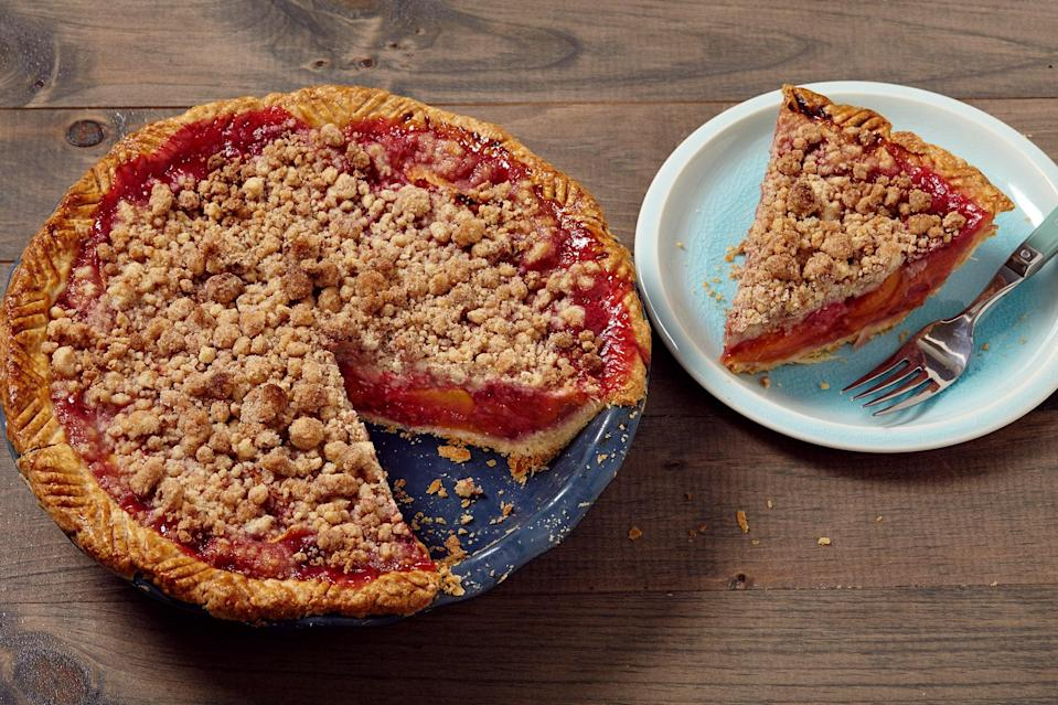 "You don't need a rolling pin for this gorgeous pie! The simple press-in dough does double duty for both the crust and the crumb topping. Bonus: This recipe can also be baked in a muffin tin to make mini pies. <a href=""https://www.epicurious.com/recipes/food/views/the-easiest-peach-raspberry-pie-with-press-in-crust-56389627?mbid=synd_yahoo_rss"" rel=""nofollow noopener"" target=""_blank"" data-ylk=""slk:See recipe."" class=""link rapid-noclick-resp"">See recipe.</a>"