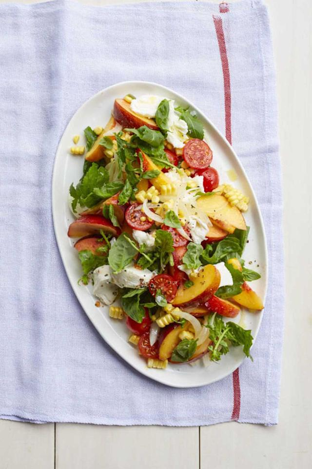 """<p>Peach slices bring a refreshing new spin to the Italian salad.</p><p><strong><a rel=""""nofollow"""" href=""""https://www.womansday.com/food-recipes/food-drinks/recipes/a55295/peach-caprese-salad-recipe/"""">Get the recipe.</a></strong></p>"""