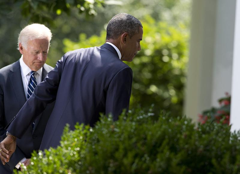 Vice President Joe Biden, left, follows President Barack Obama as he leaves the Rose Garden after making a statement about the crisis in Syria at the White House in Washington Saturday, Aug. 31, 2013 in Washington. Obama said he has decided that the United States should take military action against Syria in response to a deadly chemical weapons attack. But he said he will seek congressional authorization for the use of force. (AP Photo/Evan Vucci)