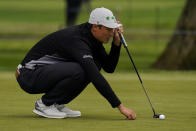 Li Haotong of China, lines up a putt on the second hole during the third round of the PGA Championship golf tournament at TPC Harding Park Saturday, Aug. 8, 2020, in San Francisco. (AP Photo/Jeff Chiu)