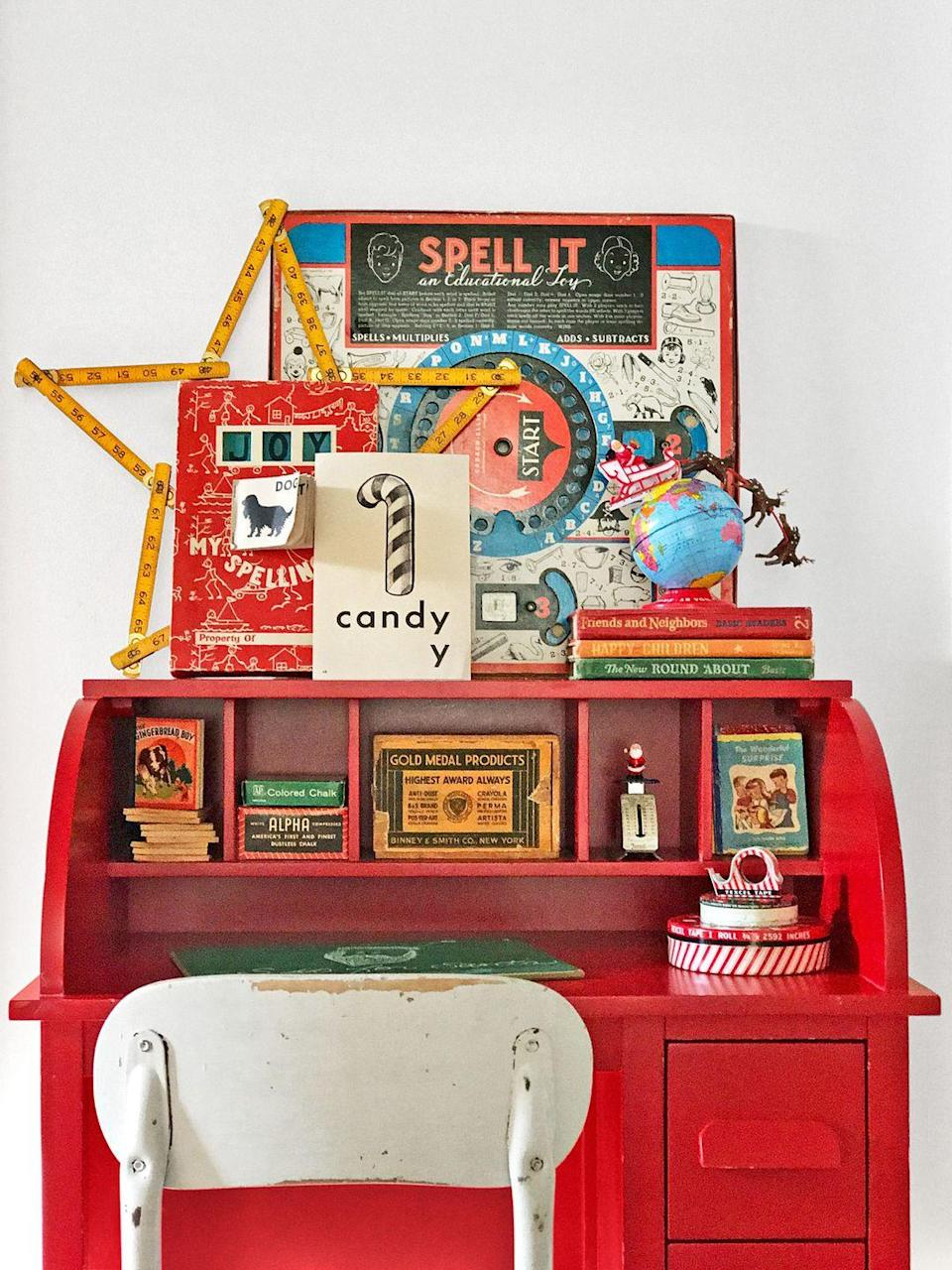 """<p>Striped tape dispensers, Christmas-inspired flashcards, and other vintage school supplies look positively merry on this desk. The rulers in the shape of a star have to be our favorite part though.</p><p><a class=""""link rapid-noclick-resp"""" href=""""https://www.amazon.com/Vintage-Advertisement-Cocoa-Christmas-Plaque/dp/B075XQ9S1T?tag=syn-yahoo-20&ascsubtag=%5Bartid%7C10050.g.1247%5Bsrc%7Cyahoo-us"""" rel=""""nofollow noopener"""" target=""""_blank"""" data-ylk=""""slk:SHOP VINTAGE SIGNS"""">SHOP VINTAGE SIGNS</a></p>"""