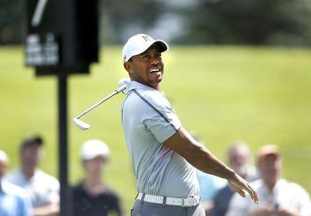 Tiger Woods reacts to his tee shot on the seventh hole during the first round of the WGC-Bridgestone Invitational golf tournament at Firestone Country Club - South Course. July 31, 2014. Akron Mandatory Credit: Joe Maiorana