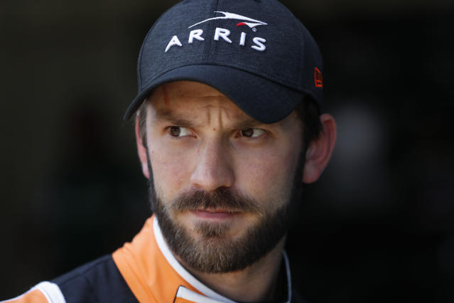 Daniel Suarez watches during practice for a NASCAR Cup Series auto race at Michigan International Speedway in Brooklyn, Mich., Saturday, Aug. 10, 2019. (AP Photo/Paul Sancya)