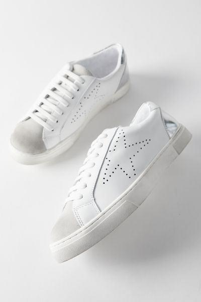 <p>If you're not a fan of the crisp and clean, dental white look, you'll appreciate the bit of wear the <span>Steve Madden Rezza Sneaker</span> ($90) has.</p>