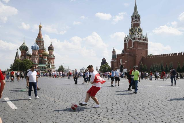 Soccer Football - World Cup - Group H - Poland vs Senegal - Moscow, Russia - June 19, 2018 A Poland's fan plays with the ball at the Red Square before the match. REUTERS/Gleb Garanich