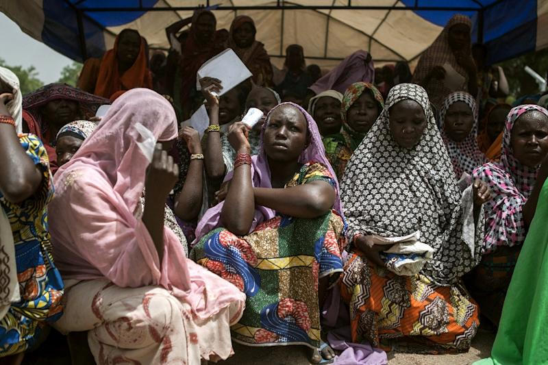 Women wait for food distribution in the town of Banki in northeastern Nigeria in April 2017 as conflict and the risk of famine heighten (AFP Photo/FLORIAN PLAUCHEUR)