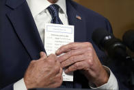 FILE - In this April 14, 2021, file photo President Joe Biden puts a card into his pocket as he speaks from the Treaty Room in the White House about the withdrawal of the remainder of U.S. troops from Afghanistan. (AP Photo/Andrew Harnik, Pool, File)