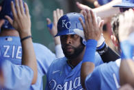 Kansas City Royals' Carlos Santana celebrates in the dugout after scoring from third on Hunter Dozier sacrifice fly ball during the third inning of a baseball game against the Chicago White Sox at Kauffman Stadium in Kansas City, Mo., Thursday, July 29, 2021. (AP Photo/Colin E. Braley)