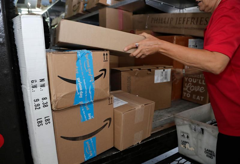 Amazon Prime and other packages are unloaded from an UPS delivery truck before being unloaded in Miami, Tuesday, July 17, 2018. Amazon Prime Day was launched July 16 and and will be six hours longer than last year's and will launch new products. (AP Photo/Lynne Sladky)