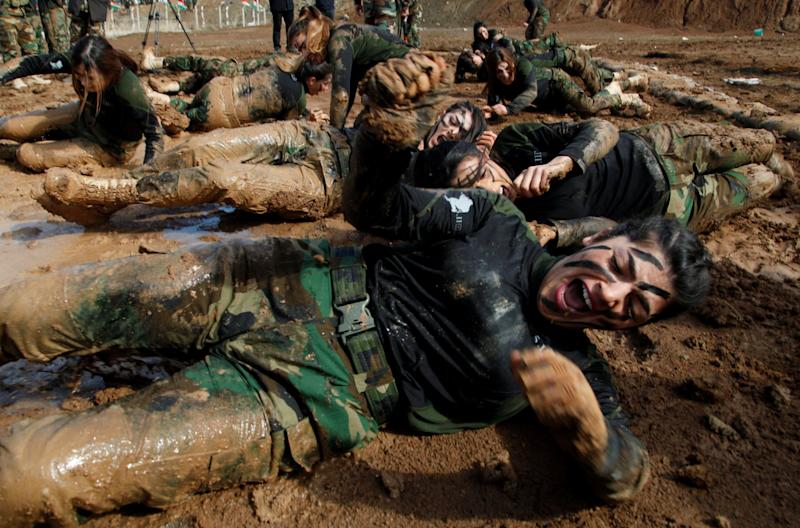Female fighters crawled through mud (Reuters)