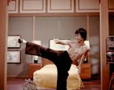 <p>In a scene from the 1973 film <em>Enter</em> <em>the Dragon, </em>Bruce Lee showcases his toned muscles. Not only that, but the Chinese-American actor helped bring martial arts to the forefront in America.</p>