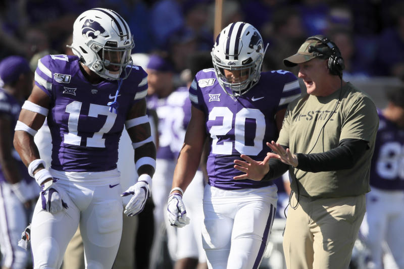 Kansas State head coach Chris Klieman, right, talks with defensive backs Jonathan Alexander (17) and Denzel Goolsby (20) during the first half of an NCAA college football game against Baylor in Manhattan, Kan., Saturday, Oct. 5, 2019. (AP Photo/Orlin Wagner)