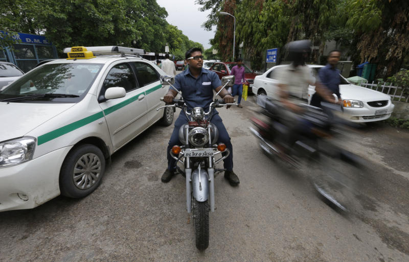 In this Tuesday, Aug. 21, 2012 photo, Pradeep Kumar rides his motorbike as he heads to work at the Deen Dayal Upadhyay Hospital in New Delhi, India.  Kumar and 20 other bouncers have been hired to protect doctors as well as keep the emergency and labor rooms from filling up with patients' often agitated relatives and friends.  (AP Photo/Saurabh Das)
