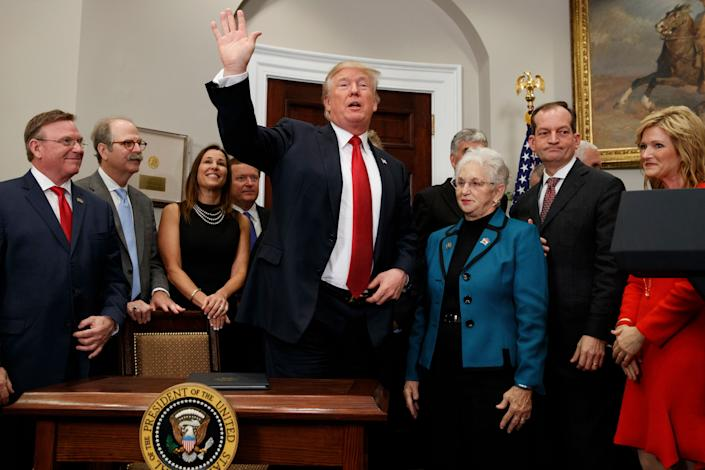 President Donald Trump waves after signing an executive order on health care in the Roosevelt Room of the White House, Oct. 12, 2017, in Washington. (Photo: Evan Vucci/AP)