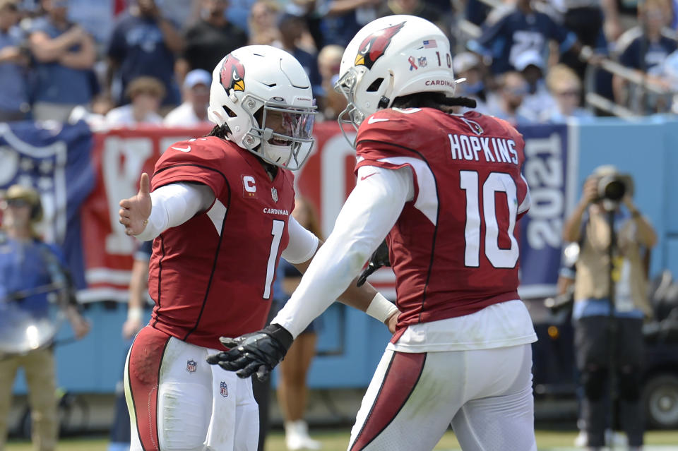 Arizona Cardinals quarterback Kyler Murray (1) is congratulated by wide receiver DeAndre Hopkins (10) after Murray ran for a touchdown against the Tennessee Titans in the first half of an NFL football game Sunday, Sept. 12, 2021, in Nashville, Tenn. (AP Photo/Mark Zaleski)